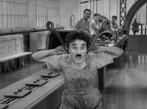 """In foto: Charlie Chaplin nel film """"Modern Times"""""""